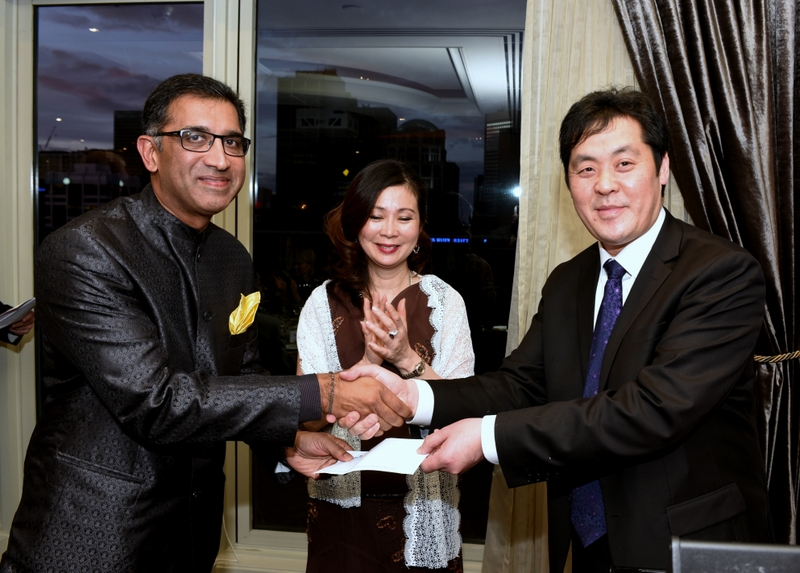 Richard Wong and Grace Lim from the Asian Executive present a cheque accepted by Harish Rao on behalf of the Australian Friends of Asha.