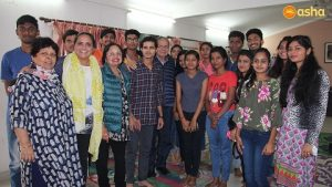Dr Monica and her parents posing with Asha students and Ms Rani (L), Asha Supervisor