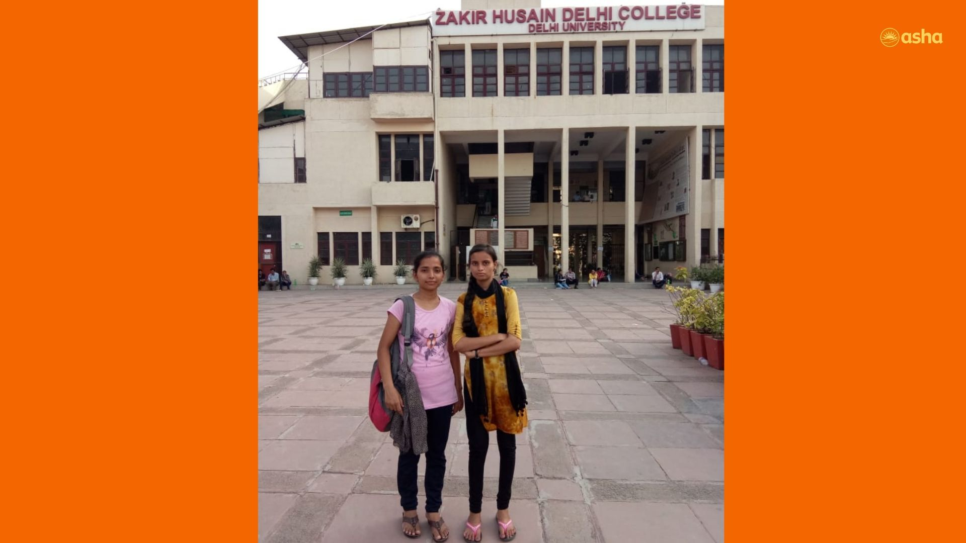 Archana (R) in front of her college