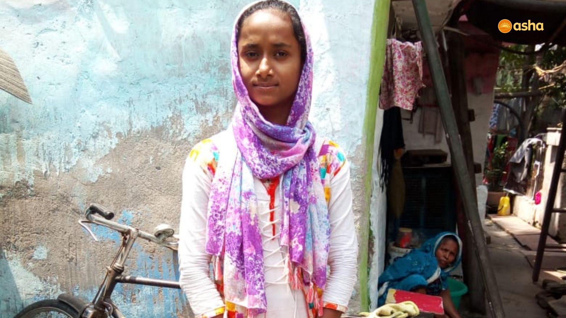 Mehjabeen in front of her shanty in Janta Camp (near Asha's Anna Nagar slum community)