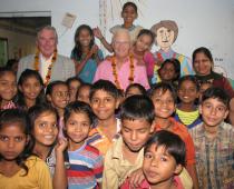 Hon.-Alex-Chernov-Governor-Victoria-with-Jeevan-Nagar-slum-children-210x170