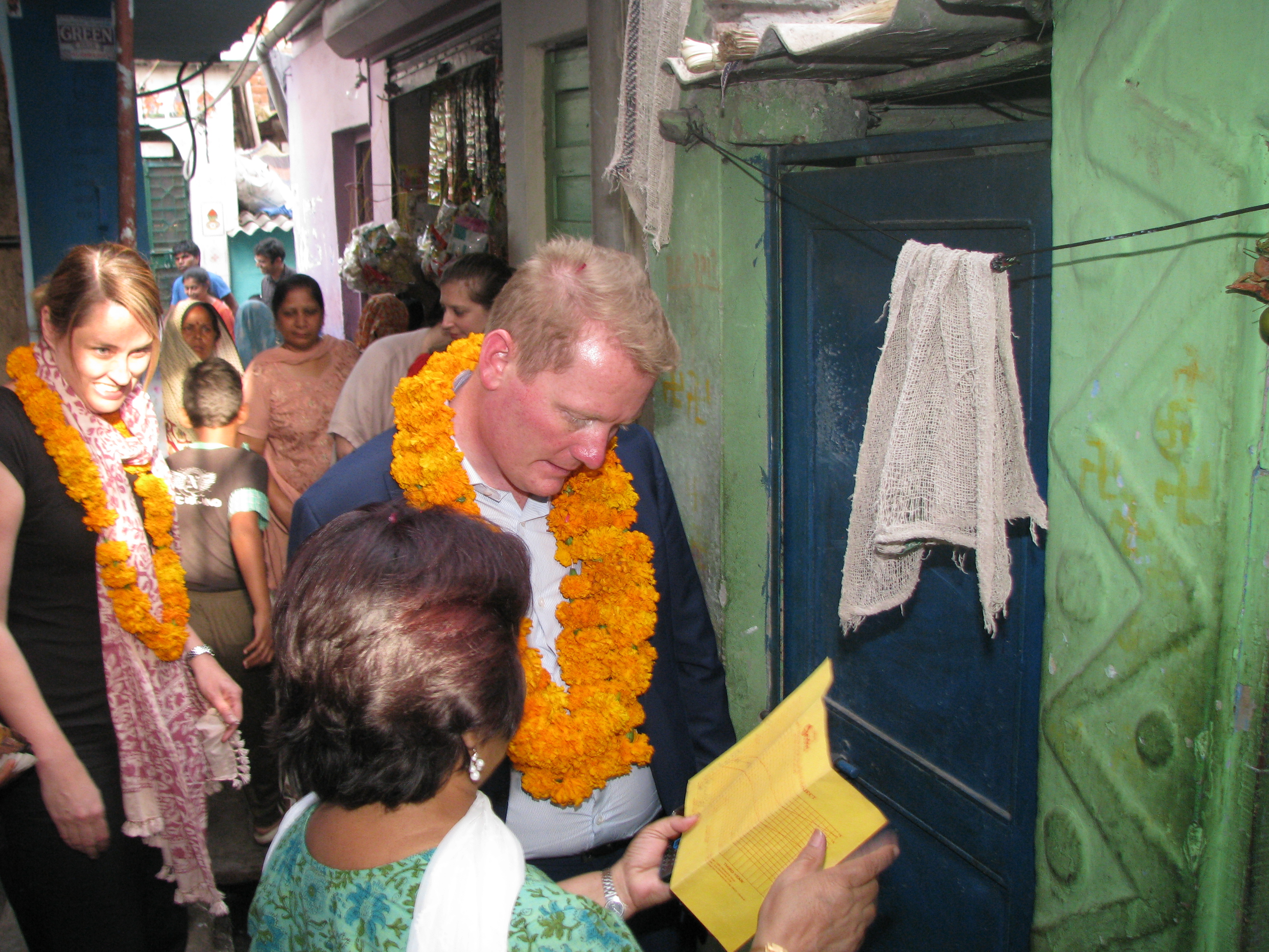 Asha staff explains a child health card to Mr. Philip