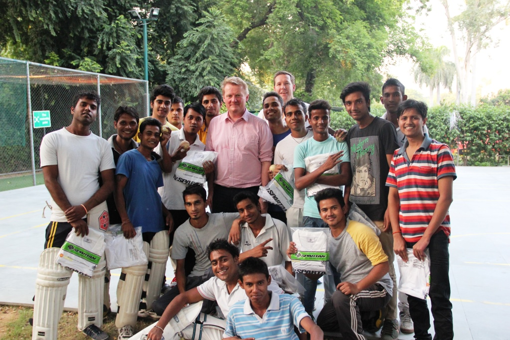 Australian Deputy High Commissioner, Mr Bernard Philip presents uniform t-shirts to the Asha students during a practice session organised earlier this month.