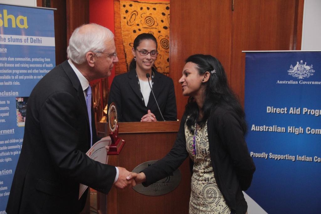 Mr Chernov congratulates Babita for her achievements