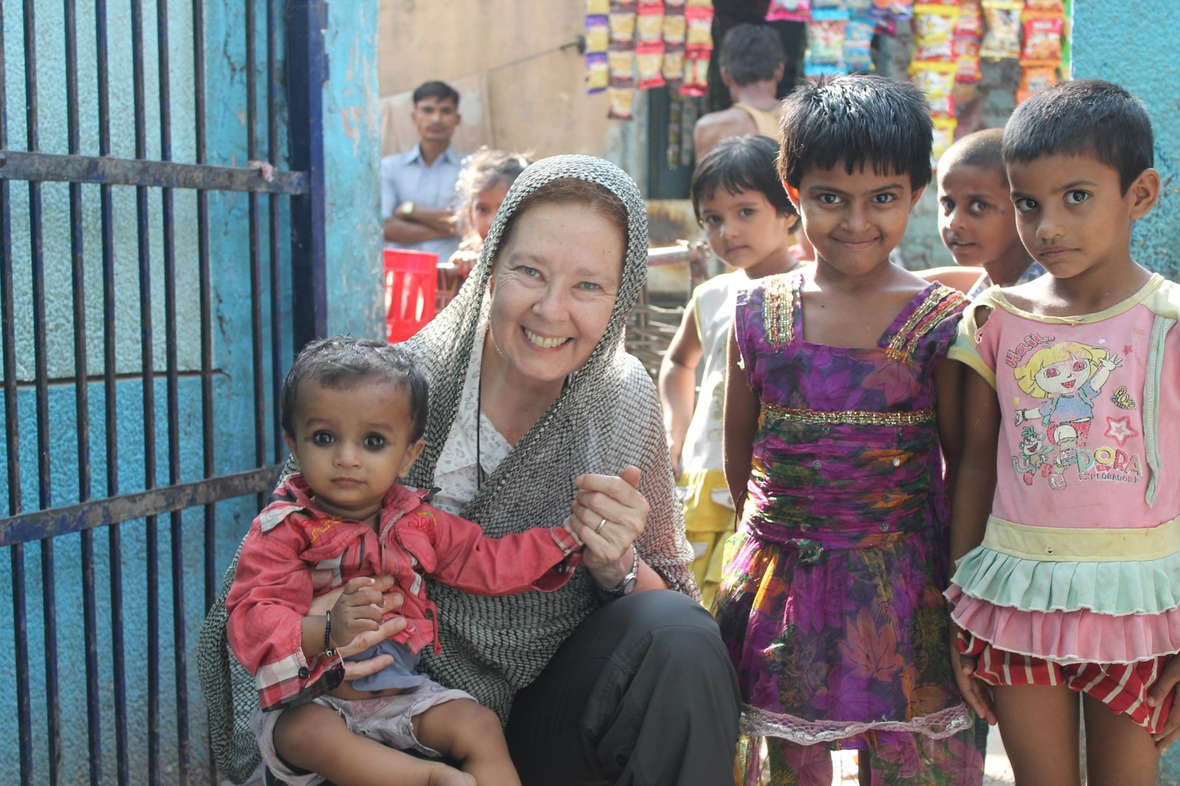 With children at Zakhira slum colony