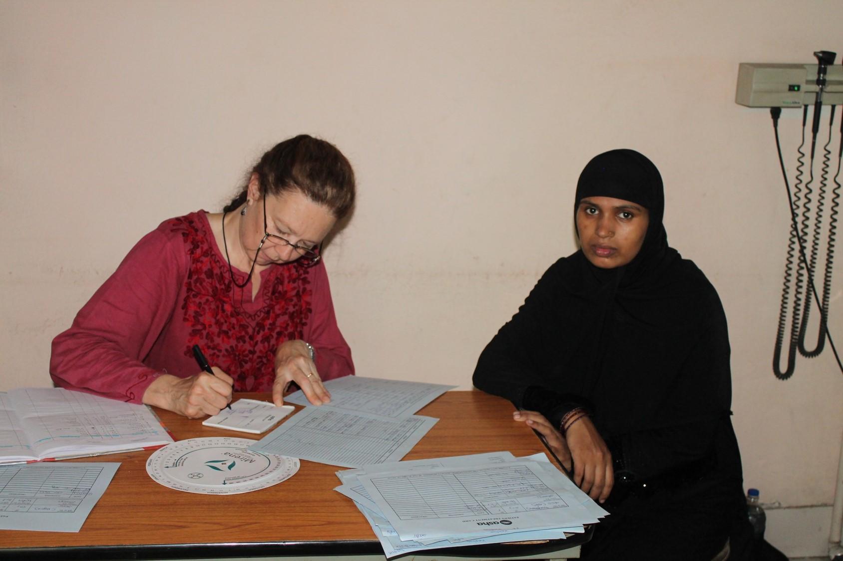 Elizabeth seeing patients at the Seelampur slum colony