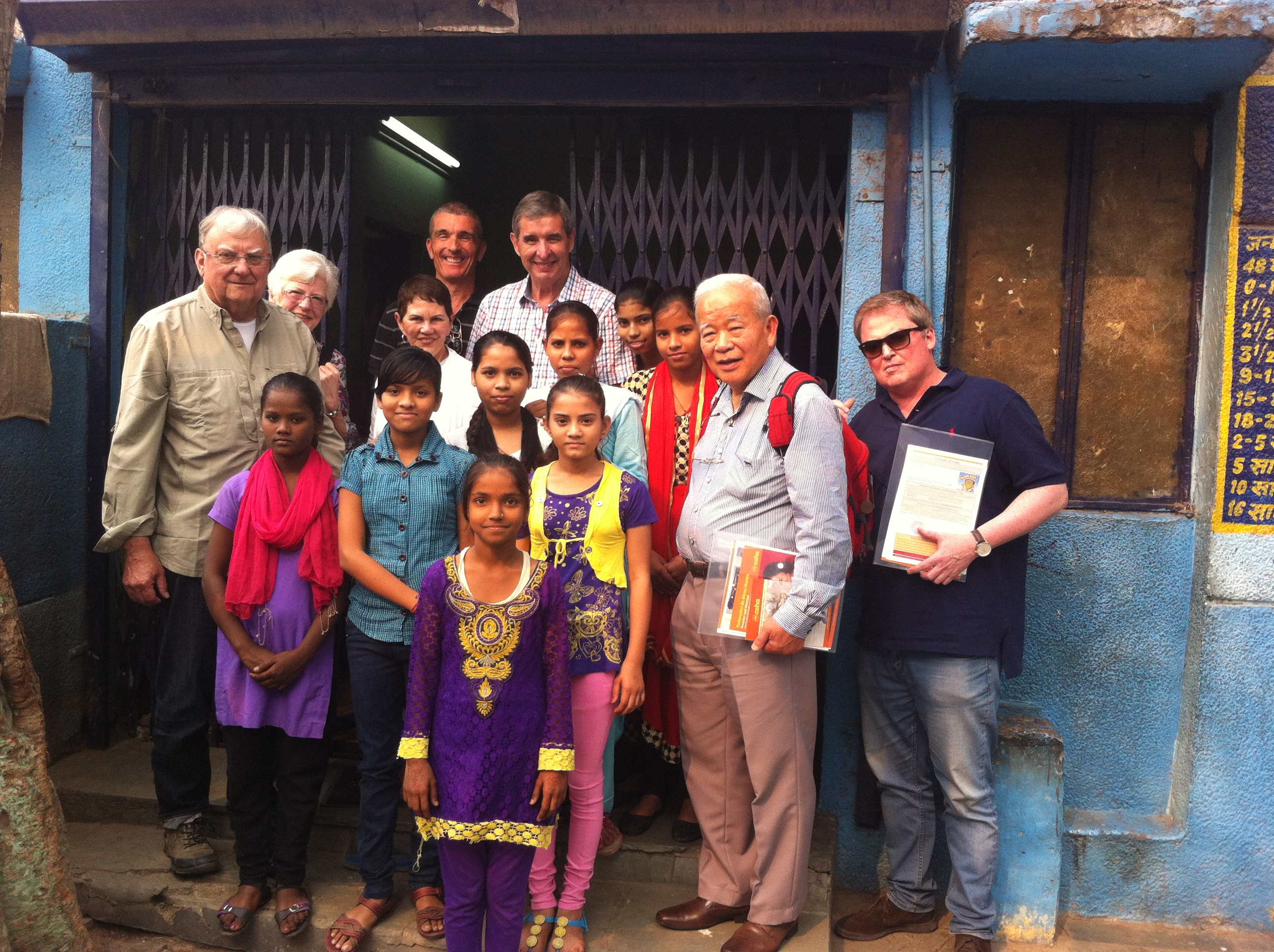 Asha students with the AWO team at Zakhira slum colony