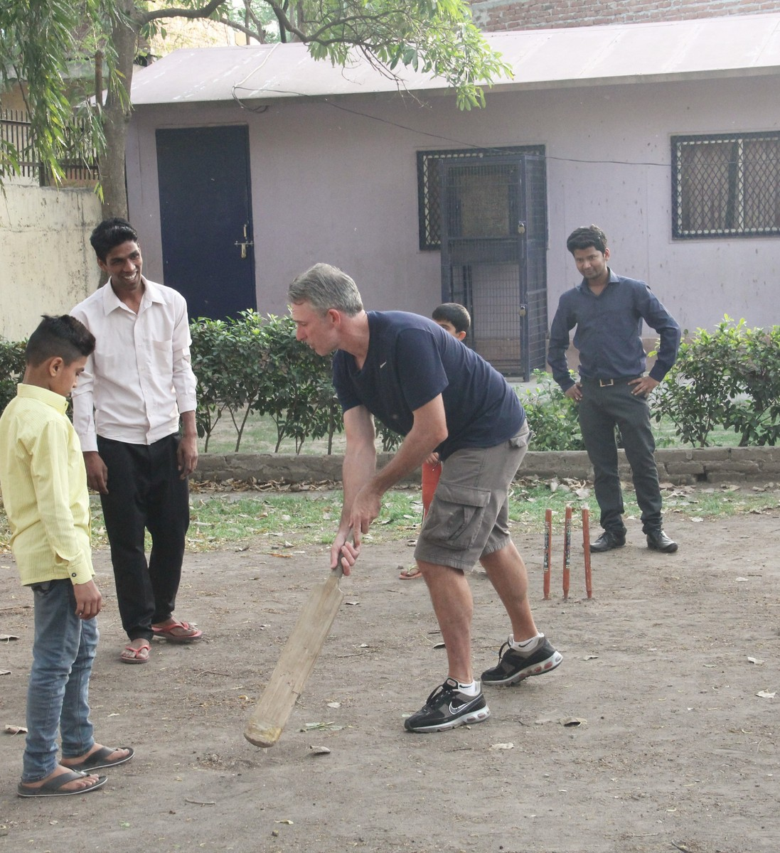 Damien teaching the Asha students some tricks of Cricket