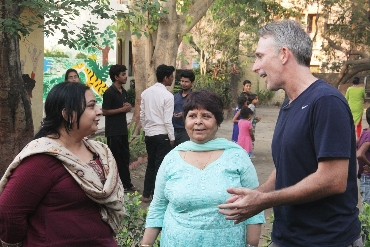 Damien interacting with the Asha team members