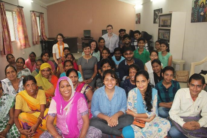 HE Ms Sidhu & Dr Kiran poses for a group photo with the women and University students.