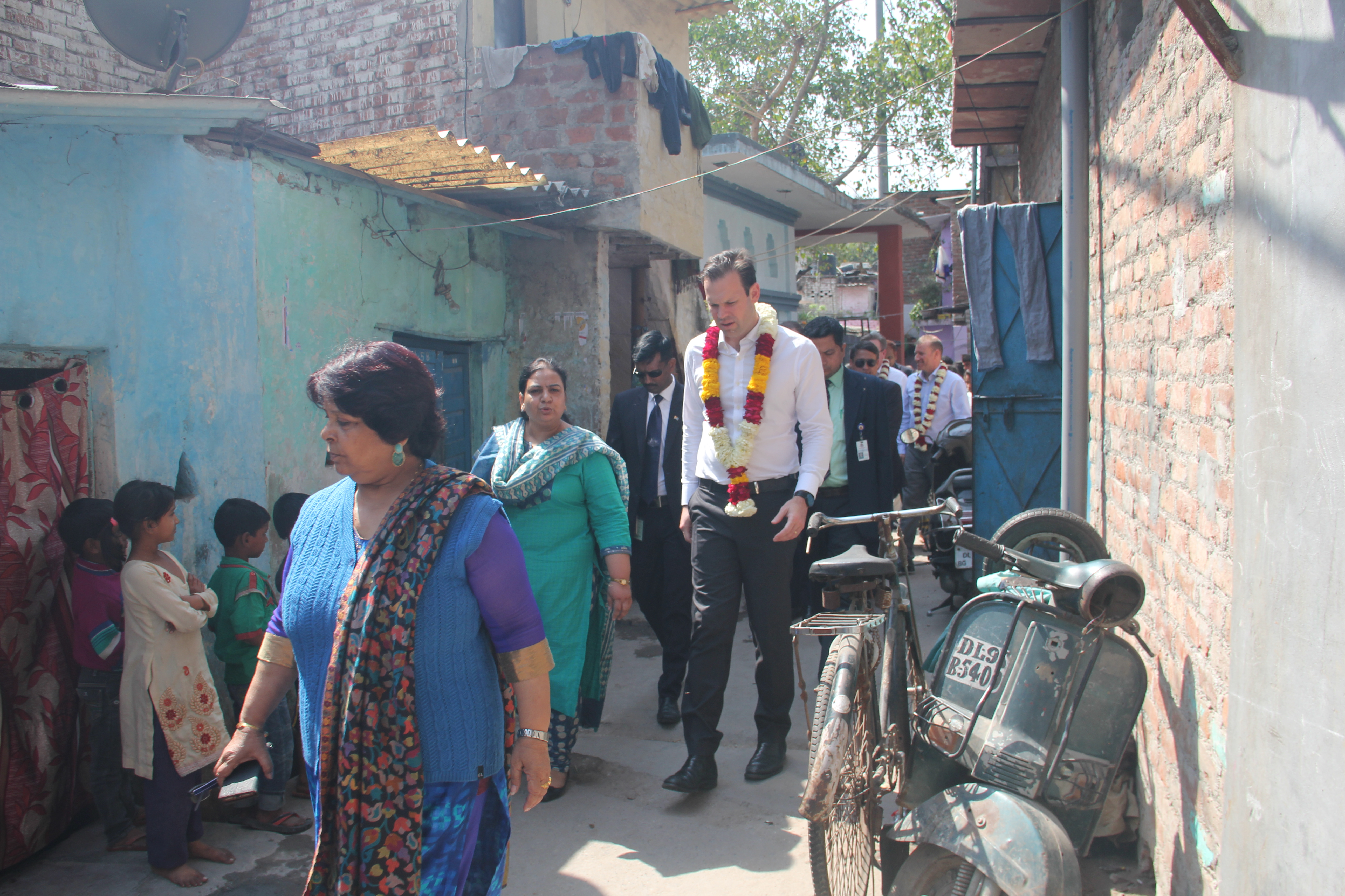 Mathew Canavan walking through the community to witness life at slums first hand.