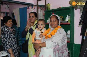 Dr Monica visiting a slum dweller's shanty