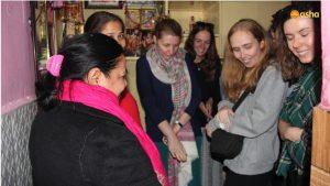 The team visiting Asha student's shanty