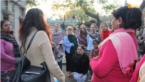 Team interacting with the Mahila Mandal members