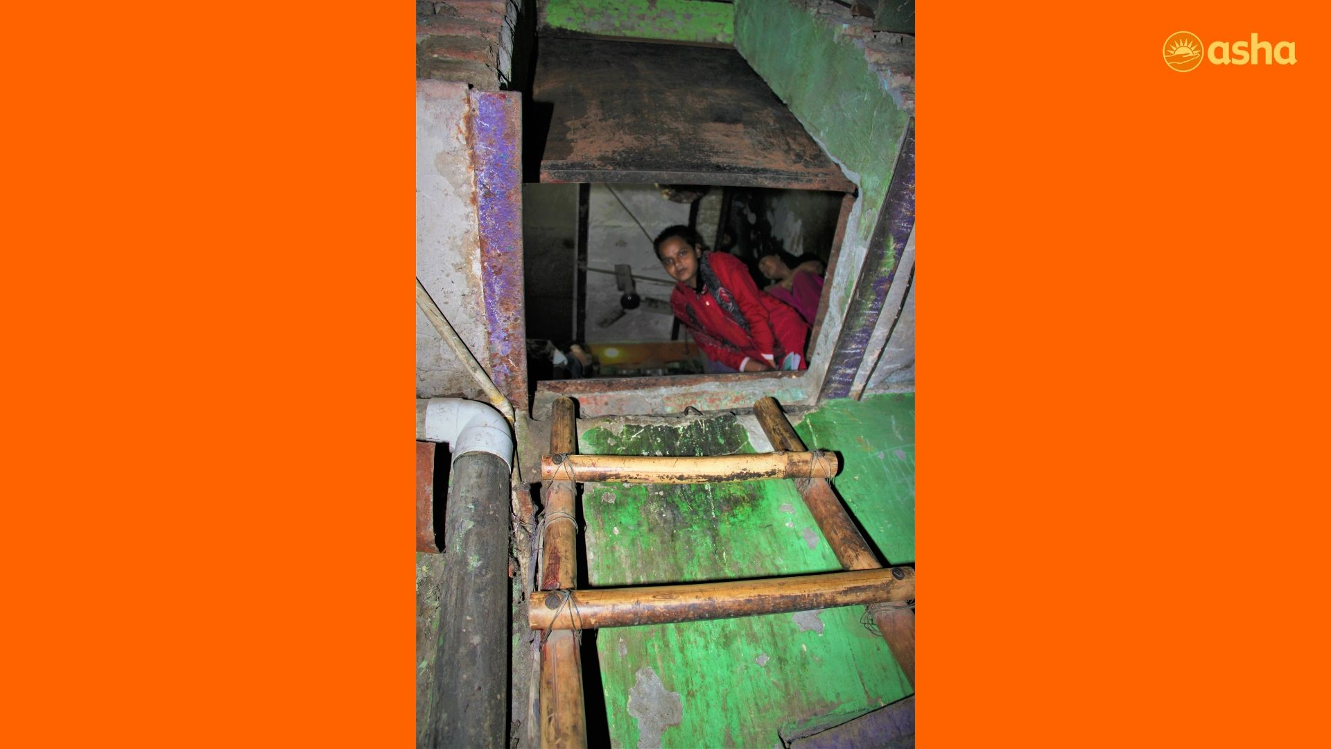 Sufiya looking out from her shanty in Asha's Seelampur slum community