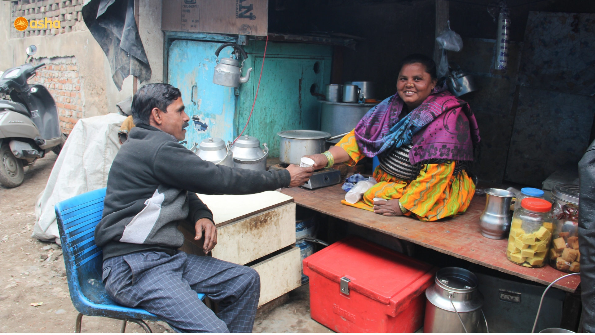 Guddi selling tea to a customer