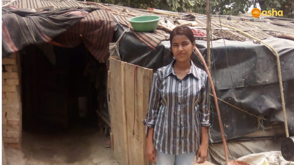 Sunaina in front of her shanty near Asha's Chanderpuri slum community