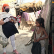 Dr Kiran visits slum families located by the riverbed
